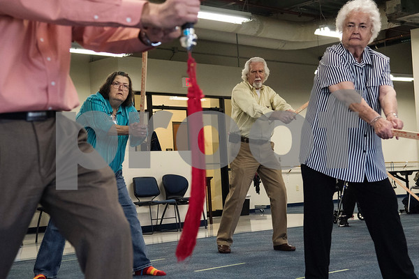 Paula Rozell of Whitehouse, Jim Law of Rusk and Sally Bradley of Flint watch Dr. Yong Wang as he leads their tai chi class at the University of Texas at Tyler Tuesday Feb. 21, 2017. The class started as a three month study on the effects of tai chi on patients with peripheral neuropathy and is continued as a community service.   (Sarah A. Miller/Tyler Morning Telegraph)