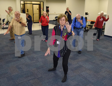 Diana Brown of Tyler, center, practices tai chi at the University of Texas at Tyler Tuesday Feb. 21, 2017. The class started as a three month study on the effects of tai chi on patients with peripheral neuropathy and is continued as a community service. Ballard created the study.  (Sarah A. Miller/Tyler Morning Telegraph)
