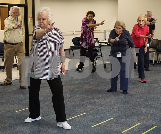 Jim Law of Rusk, Sally Bradley of Flint, Susie Square of Tyler, Carolyn Bain of Tyler, Joyce Ballard and Ralph Stewart of Flint  practice tai chi at the University of Texas at Tyler Tuesday Feb. 21, 2017. The class started as a three month study on the effects of tai chi on patients with peripheral neuropathy and is continued as a community service.   (Sarah A. Miller/Tyler Morning Telegraph)