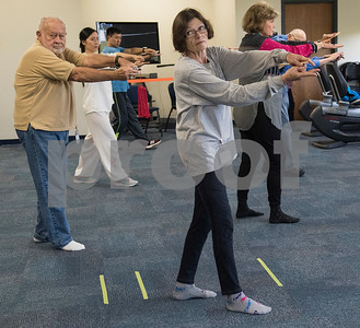 Linda Klotz of Tyler, center, practices tai chi at the University of Texas at Tyler Tuesday Feb. 21, 2017. The class started as a three month study on the effects of tai chi on patients with peripheral neuropathy and is continued as a community service. Ballard created the study.  (Sarah A. Miller/Tyler Morning Telegraph)