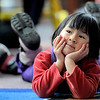 "Laying on her belly, Ling Ryan, 3, listens to Mary Jane Holland read a book during Story Time at the Boulder Public Library in Boulder, Colorado February 23, 2012. CAMERA/MARK LEFFINGWELL<br /> <br /> <br /> See video of Story Time at  <a href=""http://www.dailycamera.com"">http://www.dailycamera.com</a>"