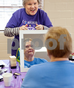 photo by Sarah A. Miller/Tyler Morning Telegraph  Avon representative Brenda Hendrickson of Ponta has Margaret Croft of Maydelle look in a mirror after giving her a makeover at Cherokee County Relay For Life's annual spa day at the Rusk Civic Center Tuesday. Croft and other cancer survivors as well as caregivers to people with cancer were invited to attend the pampering event.