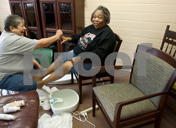 photo by Sarah A. Miller/Tyler Morning Telegraph  Diana Vega of Jacksonville washes Rusk resident Ruby Bush's feet at Cherokee County Relay For Life's annual spa day at the Rusk Civic Center Tuesday. Bush was diagnosed with breast cancer in November.