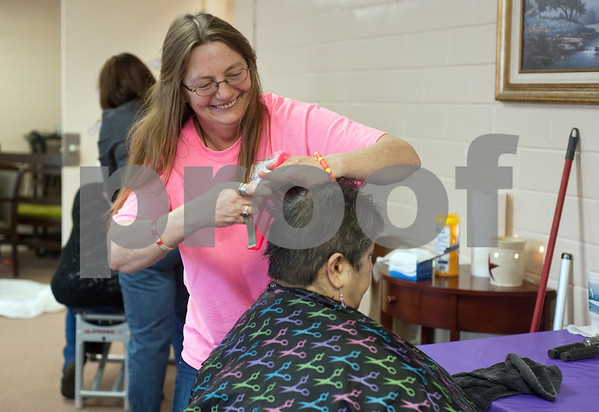 photo by Sarah A. Miller/Tyler Morning Telegraph  Cheryl Reynolds of Ironton cuts Diana Vega's hair at Cherokee County Relay For Life's annual spa day at the Rusk Civic Center Tuesday.