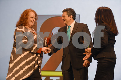 Terri Smith of Children's Advocacy Center of Smith County accepts the award for non-profit business of the year from David Stein and Mechele Mills at the Better Business Bureau Awards for Excellence held Tuesday Feb. 7, 2017 at Green Acres Baptist Church.  (Sarah A. Miller/Tyler Morning Telegraph)