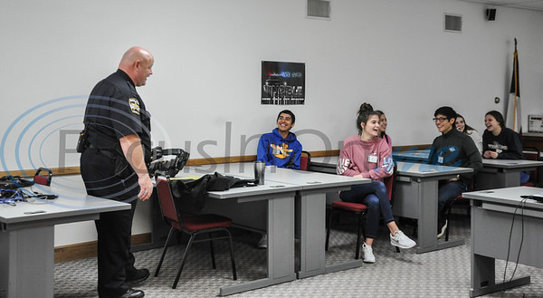 Captain Price of the Jacksonville Police Department jokes with Jacksonville High School students during a Job Shadowing event on Thursday, February 7. 40 schools, 15 business and 5 colleges participated in the event. (Jessica T. Payne/Tyler Morning Telegraph)