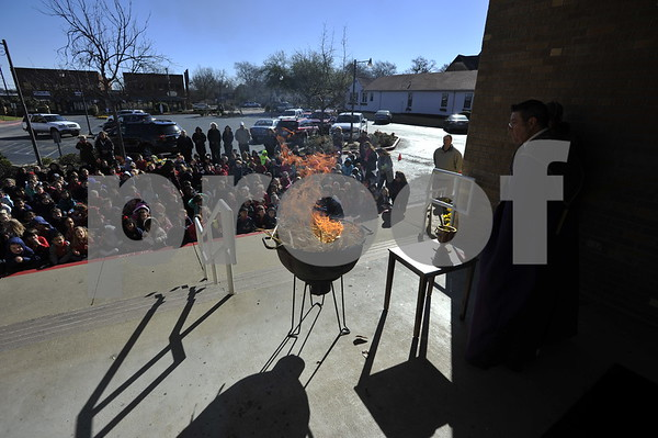 Burning the Palms for Ash Wednesday