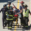 BE0912LAF06.jpg BE0912accident01<br /> Lafayette Fire firefighters move an accident victim from a North Colorado Medical helicopter at the scene of an accident between a small pickup and a semi truck on north bound US 287 north of South Boulder Road on Friday.<br /> <br /> September 10, 2010<br /> staff photo/David R. Jennings