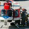 BE0912LAF02.jpg BE0912accident02<br /> Lafayette Fire firefighters move an accident victim from a North Colorado Medical Center helicopter to an ambulance at the scene of an accident between a small pickup and a semi truck on north bound US 287 north of South Boulder Road on Friday.<br /> <br /> September 10, 2010<br /> staff photo/David R. Jennings