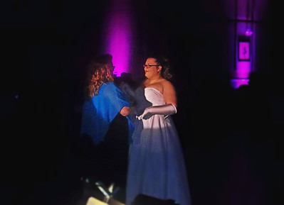 """NIKKI RHOADES / GAZETTE Celine Bartish greets her mother with a bouquet of flowers as part of her formal """"debut into society."""" After each honoree's introduction, they returned to the dance floor."""
