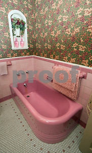 photo by Sarah A. Miller/Tyler Morning Telegraph  Visitors can view this bathroom adorned with a pink bathtub and tiles inside the Wiley-Kesler House during the Historic Tyler on Tour home tour Saturday March 28 and Sunday March 29. The historic home was built in 1890.