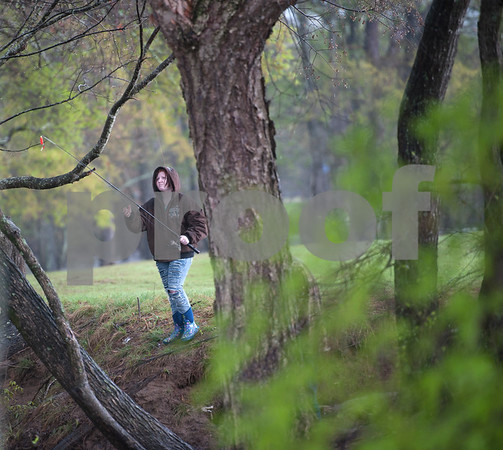 Hannah Jensen of Kilgore fishes at River Park in Chandler, Texas Saturday March 12, 2016. Rainy conditions did not stop several dozen fishers from coming to the park, situated along the Niches River, to catch sand bass and catfish.   (Sarah A. Miller/Tyler Morning Telegraph)