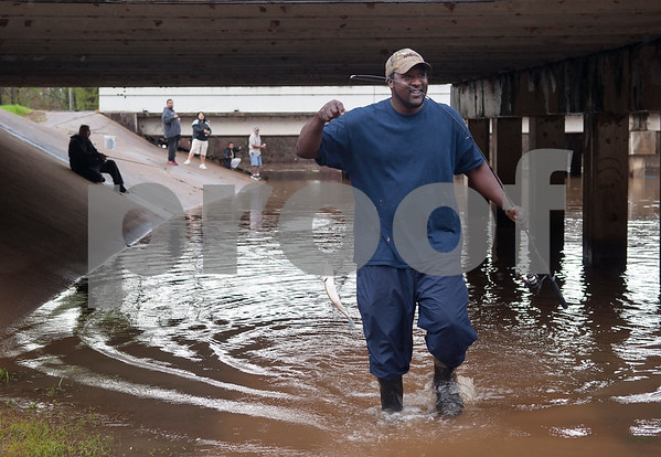 Dan Strain of Tyler catches a fish at River Park in Chandler, Texas Saturday March 12, 2016. Rainy conditions did not stop several dozen fishers from coming to the park, situated along the Niches River, to catch sand bass and catfish.   (Sarah A. Miller/Tyler Morning Telegraph)