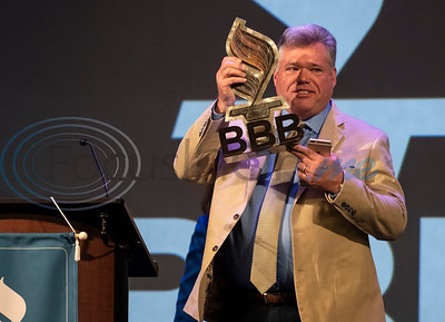 Outgoing Better Business Bureau Board Chairman Paul Ingle receives an award during Better Business Bureau's Awards for Excellence luncheon held at Green Acres Cross Walk Center in Tyler on Tuesday March 12, 2019.  (Sarah A. Miller/Tyler Morning Telegraph)