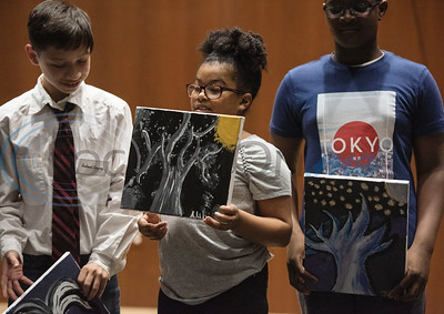 Andrew Gauna, Aamiyah Warren and Tristen Taylor hold up paintings they made during a spring break camp hosted by the non-profit organization Kids Aspiring To Dream in partnership with the University of Texas at Tyler on Tuesday March 12, 2019.  (Sarah A. Miller/Tyler Morning Telegraph)