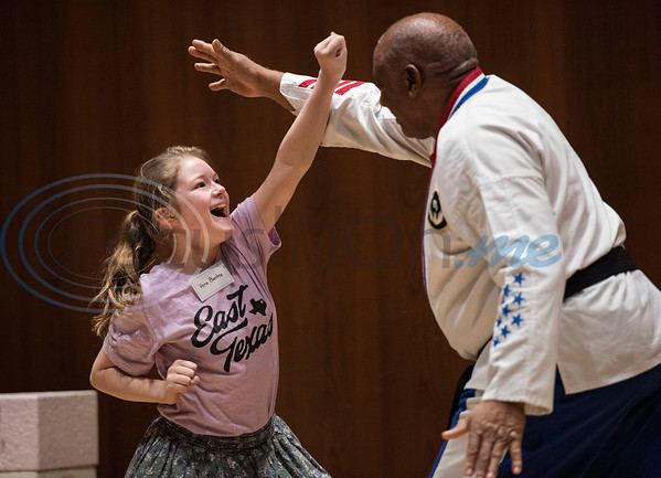 Vera Banta, 11, of Tyler, shows off a karate block with instructor Alvin Harold during a spring break camp hosted by the non-profit organization Kids Aspiring To Dream in partnership with the University of Texas at Tyler on Tuesday March 12, 2019.  (Sarah A. Miller/Tyler Morning Telegraph)