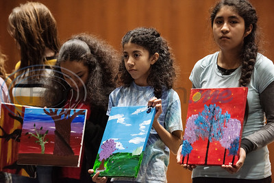 Campers hold up paintings they made during a spring break camp hosted by the non-profit organization Kids Aspiring To Dream in partnership with the University of Texas at Tyler on Tuesday March 12, 2019.  (Sarah A. Miller/Tyler Morning Telegraph)