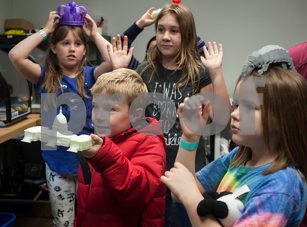 Students hold their favorite 3D printed objects while on a tour of the Innovation Pipeline that was part of Discovery Science Place's Make Structures engineering-themed spring break camp on Monday March 12, 2018.  (Sarah A. Miller/Tyler Morning Telegraph)