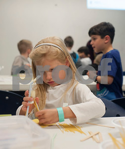 Audrey Florey, 6, builds a structure during Discovery Science Place's Make Structures spring break camp on Monday March 12, 2018.  (Sarah A. Miller/Tyler Morning Telegraph)