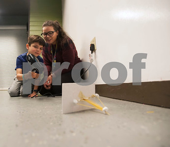 Instructor Lauen Renteria assists Samuel Iglesias, 6, as he uses a hairdryer to blow over his structure during Discovery Science Place's Make Structures spring break camp on Monday March 12, 2018.  (Sarah A. Miller/Tyler Morning Telegraph)