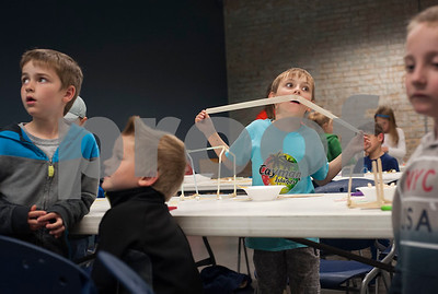 Jayden Doan, 6, plays with his piece of tape before using it to build a structure at Discovery Science Place's Make Structures spring break camp on Monday March 12, 2018.  (Sarah A. Miller/Tyler Morning Telegraph)