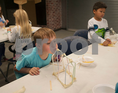 Jayden Doan, 6, tests his structure's durability by blowing on it at Discovery Science Place's Make Structures spring break camp on Monday March 12, 2018.  (Sarah A. Miller/Tyler Morning Telegraph)
