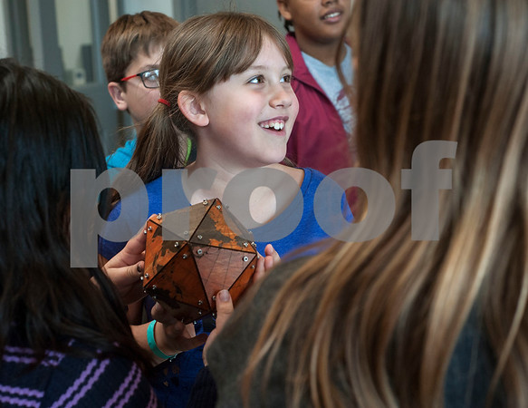 Chloe Collins, 8, passes an object around to other campers while on a tour of the Innovation Pipeline that was part of Discovery Science Place's Make Structures engineering-themed spring break camp on Monday March 12, 2018.  (Sarah A. Miller/Tyler Morning Telegraph)