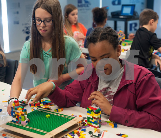 Katelyn Martinez, 9, and Emabete Hardwick, 12, work together to build a structurally strong Lego tower during Discovery Science Place's Make Structures spring break camp on Monday March 12, 2018.  (Sarah A. Miller/Tyler Morning Telegraph)