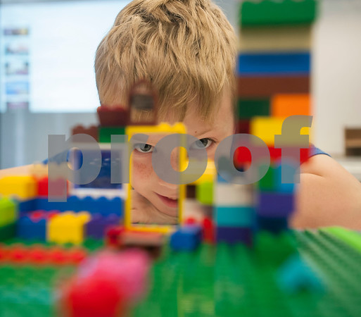 August Menninger, 8, builds a Lego structure during Discovery Science Place's Make Structures spring break camp on Monday March 12, 2018.  (Sarah A. Miller/Tyler Morning Telegraph)