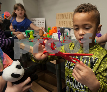 Jordan Ware, 8, looks at a 3D printed pair of scissors while on a tour of the Innovation Pipeline that was part of Discovery Science Place's Make Structures engineering-themed spring break camp on Monday March 12, 2018.  (Sarah A. Miller/Tyler Morning Telegraph)