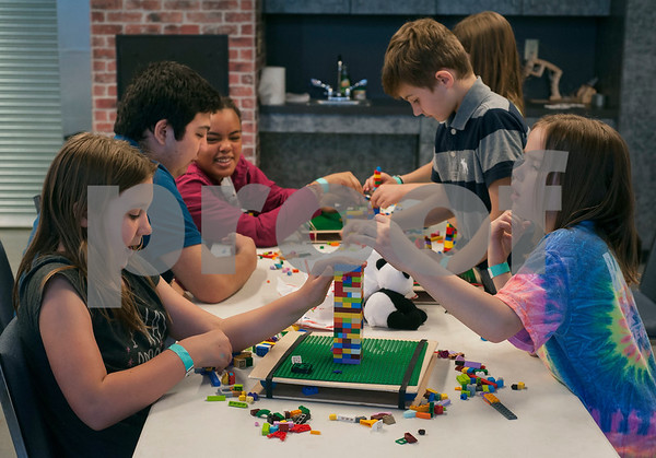 Ginger Martin, 10, and Bridget Speerly, 8, try to build the highest tower that won't fall when shaken during Discovery Science Place's Make Structures spring break camp on Monday March 12, 2018.  (Sarah A. Miller/Tyler Morning Telegraph)