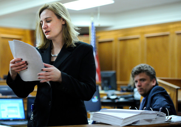 """Raszynski Trial001.JPG Prosecutor Adrian Van Nice, left, gathers paperwork for judge Thomas F. Mulvahill while prosecutor Ryan Brackley, right, watches during the Adam Raszynski trial on Wednesday, March 14, at the Boulder County Justice Center in Boulder. Rasynski is accused of stomping his mother, Rita Redford, to death after she shot him five times. For more photos of the trial go to  <a href=""""http://www.dailycamera.com"""">http://www.dailycamera.com</a><br /> Jeremy Papasso/ Camera"""