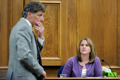 Raszynski Trial013.JPG Defense attorney Seth Temin questions Amber Grantham, of the Boulder County Coroners Office, as she gives her testimony during the Adam Raszynski trial on Wednesday, March 14, at the Boulder County Justice Center in Boulder. Rasynski is accused of stomping his mother, Rita Redford, to death after she shot him five times. For more photos of the trial go to www.dailycamera.com Jeremy Papasso/ Camera