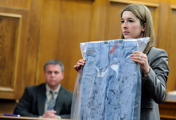 "Raszynski Trial015.JPG Defense attorney Kathryn Herold displays a pair of blood-stained jeans taken off of Adam Raszynski's body to the jury as a defense exhibit during the Adam Raszynski trial on Wednesday, March 14, at the Boulder County Justice Center in Boulder. Rasynski is accused of stomping his mother, Rita Redford, to death after she shot him five times. For more photos of the trial go to  <a href=""http://www.dailycamera.com"">http://www.dailycamera.com</a><br /> Jeremy Papasso/ Camera"