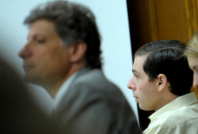 Adam Raszynski (right) sits with his attorney Seth Temin (left) during the opening of his trial at the Boulder County Justice Center in Boulder, Colorado March 14, 2012. Rasynski is accused of stomping his mother, Rita Redford, to death after she shot him five times. CAMERA/MARK LEFFINGWELL