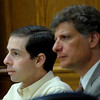 Adam Raszynski (left) and his attorney Seth Temin (right) listen to defense attorney Kathryn Herold give her opening statement his Raszynski's trial at the Boulder County Justice Center in Boulder, Colorado March 14, 2012. Rasynski is accused of stomping his mother, Rita Redford, to death after she shot him five times. CAMERA/MARK LEFFINGWELL
