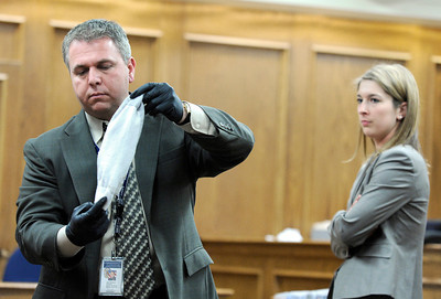 Raszynski Trial017.JPG Lafayette police detective John Dombeck displays a sock taken off of Adam Raszynski to the jury as defense attorney Kathryn Herold, right, watches during the Adam Raszynski trial on Wednesday, March 14, at the Boulder County Justice Center in Boulder. Rasynski is accused of stomping his mother, Rita Redford, to death after she shot him five times. For more photos of the trial go to www.dailycamera.com Jeremy Papasso/ Camera