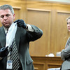 "Raszynski Trial017.JPG Lafayette police detective John Dombeck displays a sock taken off of Adam Raszynski to the jury as defense attorney Kathryn Herold, right, watches during the Adam Raszynski trial on Wednesday, March 14, at the Boulder County Justice Center in Boulder. Rasynski is accused of stomping his mother, Rita Redford, to death after she shot him five times. For more photos of the trial go to  <a href=""http://www.dailycamera.com"">http://www.dailycamera.com</a><br /> Jeremy Papasso/ Camera"