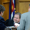 """Raszynski Trial008.JPG Judge Thomas F. Mulvahill, center, talks with prosecutor Ryan Brackley, left, and defense attorney Seth Temin, right, about some evidence during the Adam Raszynski trial on Wednesday, March 14, at the Boulder County Justice Center in Boulder. Rasynski is accused of stomping his mother, Rita Redford, to death after she shot him five times. For more photos of the trial go to  <a href=""""http://www.dailycamera.com"""">http://www.dailycamera.com</a><br /> Jeremy Papasso/ Camera"""
