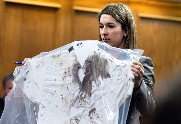 "Raszynski Trial016.JPG Defense attorney Kathryn Herold displays Adam Raszynski's blood-stained shirt to the jury as a defense exhibit during the Adam Raszynski trial on Wednesday, March 14, at the Boulder County Justice Center in Boulder. Rasynski is accused of stomping his mother, Rita Redford, to death after she shot him five times. For more photos of the trial go to  <a href=""http://www.dailycamera.com"">http://www.dailycamera.com</a><br /> Jeremy Papasso/ Camera"