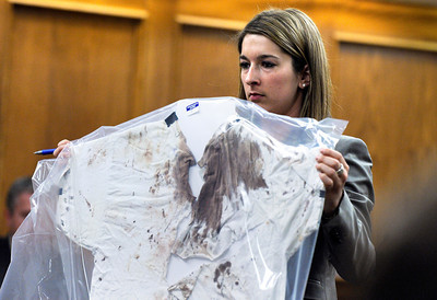 Raszynski Trial016.JPG Defense attorney Kathryn Herold displays Adam Raszynski's blood-stained shirt to the jury as a defense exhibit during the Adam Raszynski trial on Wednesday, March 14, at the Boulder County Justice Center in Boulder. Rasynski is accused of stomping his mother, Rita Redford, to death after she shot him five times. For more photos of the trial go to www.dailycamera.com Jeremy Papasso/ Camera