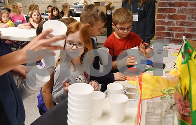 Children in the spring break at Discovery Science Place line up to get supplies to make their own Chia Pets Tuesday March 14, 2017.  (Sarah A. Miller/Tyler Morning Telegraph)