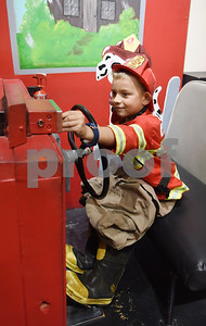 Gunner Scott, 7, of Brookeland, pretends to drive a fire engine the Discovery Science Place in downtown Tyler Tuesday March 14, 2017.  (Sarah A. Miller/Tyler Morning Telegraph)