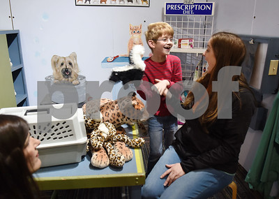 River Breedlove, 8, of Tyler, pretends to de-stink a skunk for his mother Paula Breedlove in the veterinary area of the Discovery Science Place in downtown Tyler Tuesday March 14, 2017.  (Sarah A. Miller/Tyler Morning Telegraph)