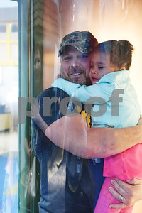 Rob Willett of Katy holds his daughter Chloe, 4, as they experience the hurricane wind simulator at Discovery Science Place in downtown Tyler Tuesday March 14, 2017.  (Sarah A. Miller/Tyler Morning Telegraph)