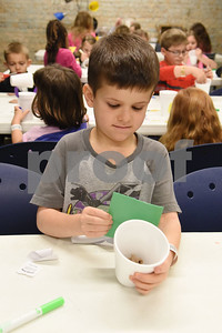 Kayden Pierce, 6, of Sulphur Springs, makes a design for his Chia Pet project during spring break camp at Discovery Science Place Tuesday March 14, 2017.  (Sarah A. Miller/Tyler Morning Telegraph)