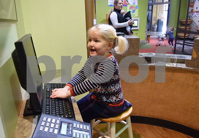 Mary Katherine Andrade, 3, of Tyler, plays in the Southside Bank exhibit at the Discovery Science Place in downtown Tyler Tuesday March 14, 2017.  (Sarah A. Miller/Tyler Morning Telegraph)