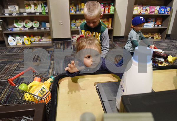 Klaira Waalwyk, 2, of Hallsville, plays in the grocery store area at the Discovery Science Place in downtown Tyler Tuesday March 14, 2017.  (Sarah A. Miller/Tyler Morning Telegraph)
