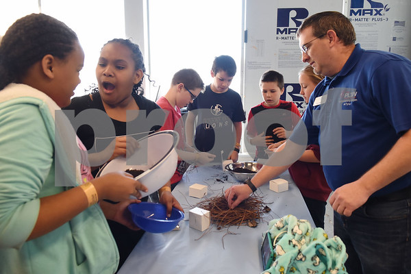 Children mix soil and other materials to create bricks during spring break camp at Discovery Science Place Tuesday March 14, 2017.  (Sarah A. Miller/Tyler Morning Telegraph)