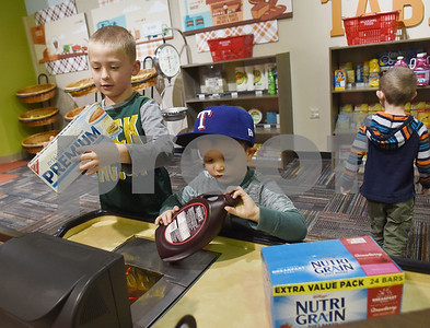Mason Kuykendall, 6, Sidney Waalwyk, 4, of Hallsville, play in the grocery store area at the Discovery Science Place in downtown Tyler Tuesday March 14, 2017.  (Sarah A. Miller/Tyler Morning Telegraph)
